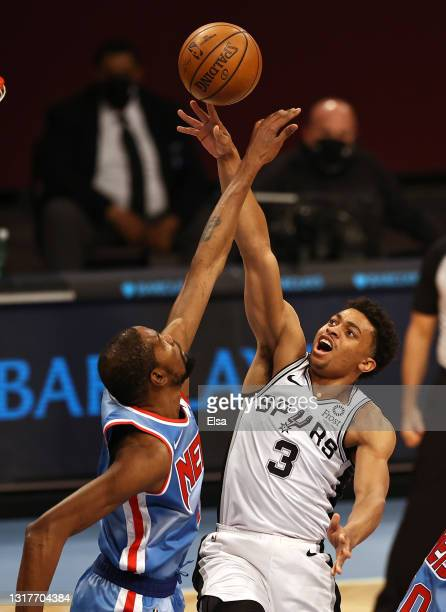 Keldon Johnson of the San Antonio Spurs heads for the net as Kevin Durant of the Brooklyn Nets defends in the first quarter at Barclays Center on May...