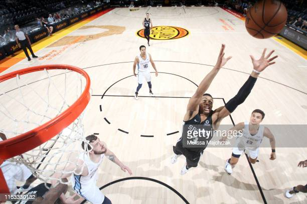 Keldon Johnson of the San Antonio Spurs reaches for the rebound against the Memphis Grizzlies on July 2 2019 at vivintSmartHome Arena in Salt Lake...