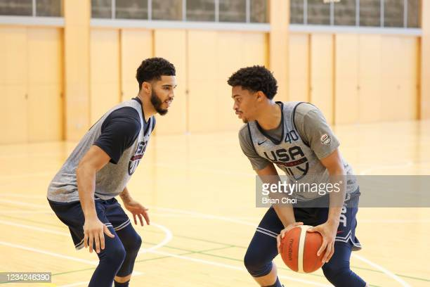 Keldon Johnson of the USA Men's National Team handles the ball as Jayson Tatum of the USA Men's National Team plays defense during the USAB Men's...