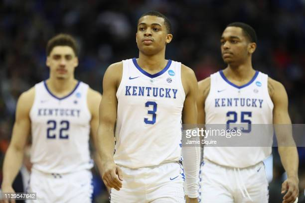 Keldon Johnson PJ Washington and Reid Travis of the Kentucky Wildcats react in the final moments of their 7771 loss to the Auburn Tigers during the...