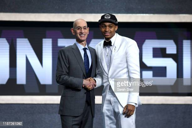 Keldon Johnson poses with NBA Commissioner Adam Silver after being drafted with the 29th overall pick by the San Antonio Spurs during the 2019 NBA...