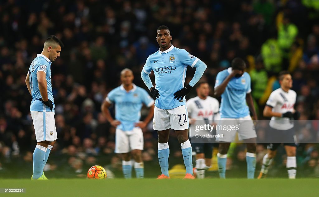 Kelechi Iheanacho and Sergio Aguero of Manchester City look dejected after the second Spurs goal during the Barclays Premier League match between Manchester City and Tottenham Hotspur at Etihad Stadium on February 14, 2016 in Manchester, England.
