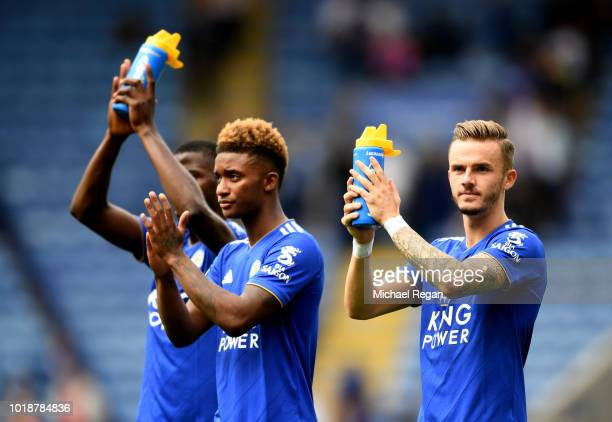 Kelechi Iheanacho Demarai Gray and James Maddison of Leicester City applaud fans following the Premier League match between Leicester City and...