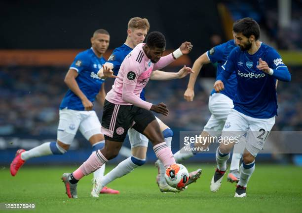 Kelechi Iheanacho of Leicester City and Andre Gomes of Everton in action during the Premier League match between Everton FC and Leicester City at...