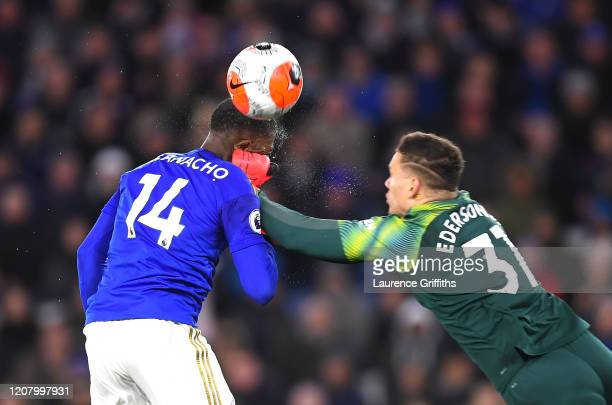 Kelechi Iheanacho of Leicester City and Ederson of Manchester City collide as they both compete for the ball during the Premier League match between...
