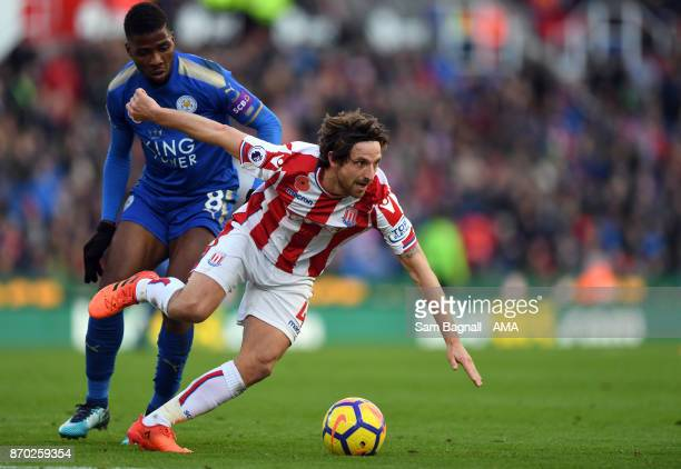 Kelechi Iheanacho of Leicester City and Joe Allen of Stoke City during the Premier League match between Stoke City and Leicester City at Bet365...