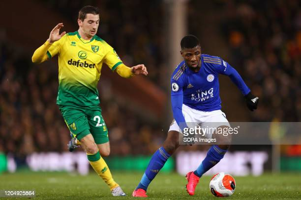 Kelechi Iheanacho of Leicester City and Kenny McLean of Norwich City in action during the Premier League match between Norwich City and Leicester...