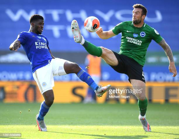 Kelechi Iheanacho of Leicester City and Shane Duffy of Brighton and Hove Albion compete for the ball during the Premier League match between...