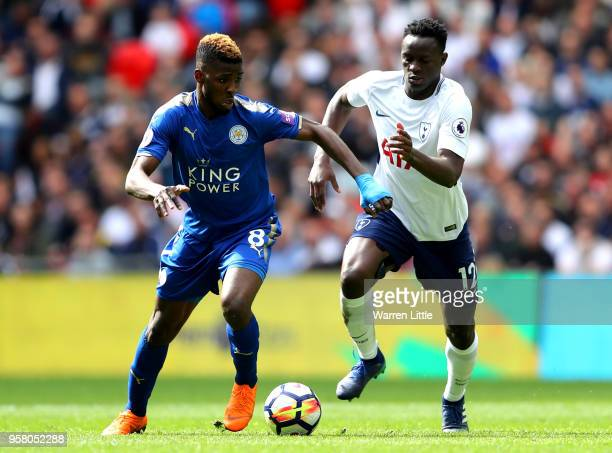 Kelechi Iheanacho of Leicester City and Victor Wanyama of Tottenham Hotspur battle for possession during the Premier League match between Tottenham...