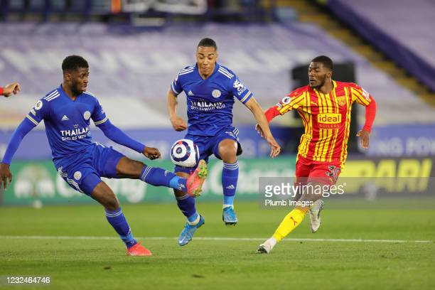 Kelechi Iheanacho of Leicester City and Youri Tielemans of Leicester City in action with Ainsley Maitland-Niles of West Bromwich Albion during the...
