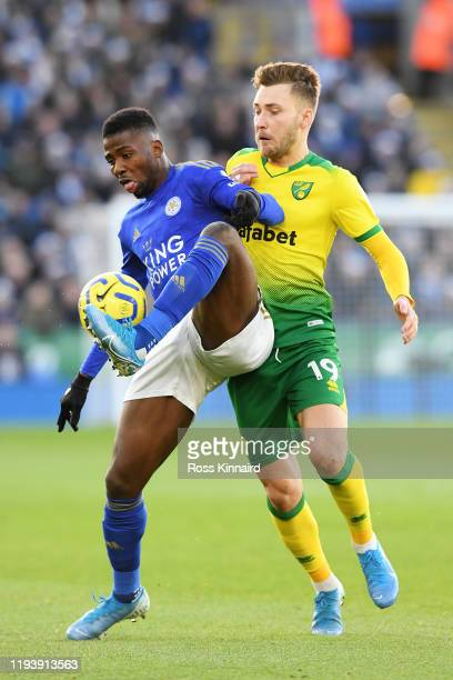Kelechi Iheanacho of Leicester City battles for possession with Tom Trybull of Norwich City during the Premier League match between Leicester City...