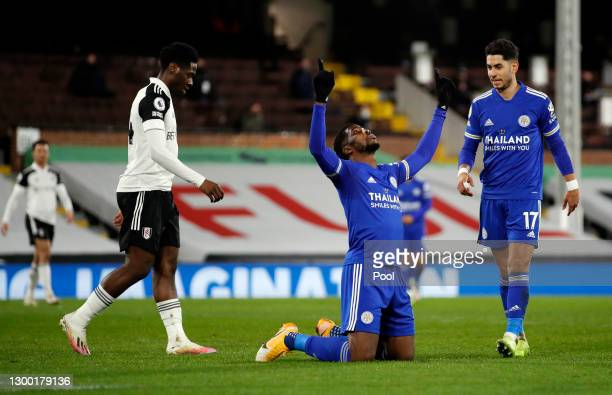 Kelechi Iheanacho of Leicester City celebrates after scoring their side's first goal as team mate Ayoze Perez looks on during the Premier League...