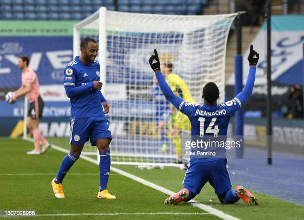Kelechi Iheanacho of Leicester City celebrates after scoring their side's first goal during the Premier League match between Leicester City and...