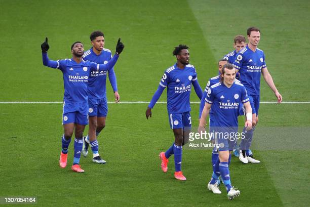Kelechi Iheanacho of Leicester City celebrates after scoring their sides third goal during the Premier League match between Leicester City and...