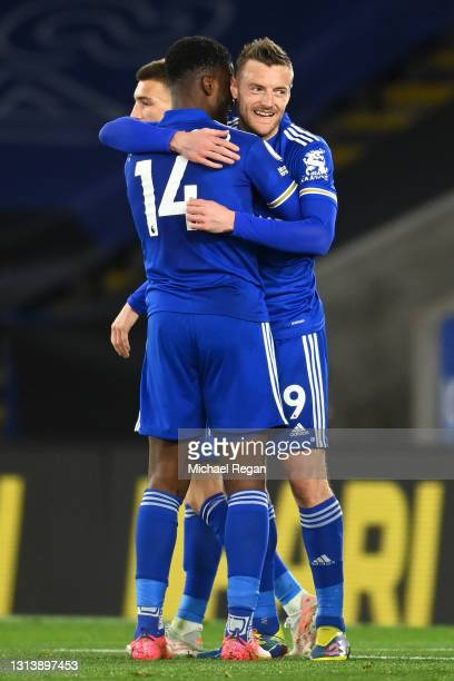 Kelechi Iheanacho of Leicester City celebrates after scoring their sides third goal with team mate Jamie Vardy during the Premier League match...