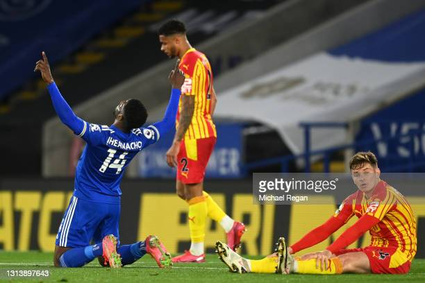 Kelechi Iheanacho of Leicester City celebrates after scoring their sides third goal as Conor Townsend of West Bromwich Albion cuts a dejected figure...
