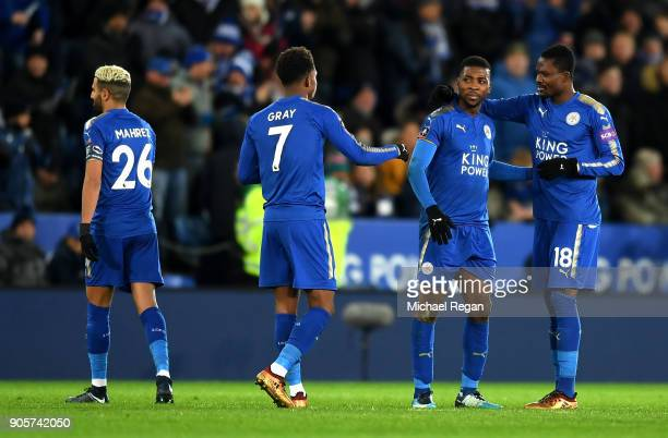 Kelechi Iheanacho of Leicester City celebrates as he scores their second goal with team mates after it was awarded following a VAR decision during...