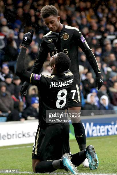 Kelechi Iheanacho of Leicester City celebrates scoring his side's third goal with Demarai Gray during The Emirates FA Cup Fourth Round match between...