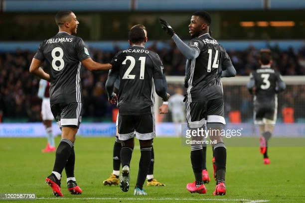 Kelechi Iheanacho of Leicester City celebrates scoring his teams first goal of the game with team mates Ricardo Pereira and Youri Tielemans during...