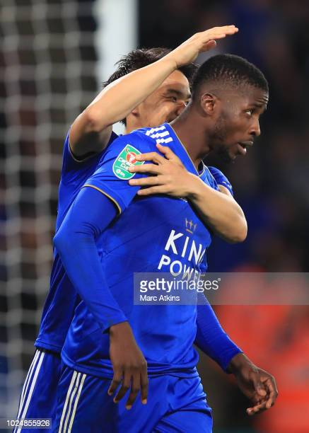 Kelechi Iheanacho of Leicester City celebrates scoring their 3rd goal with Shinji Okazaki during the Carabao Cup Second Round match between Leicester...