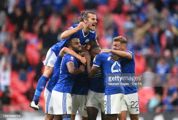 Kelechi Iheanacho of Leicester City celebrates with Caglar Soeyuencue and team mates after scoring their side's first goal during The FA Community...