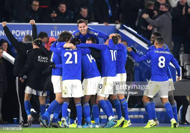Kelechi Iheanacho of Leicester City celebrates with his team mates after he scores his sides 2nd goal during the Premier League match between...