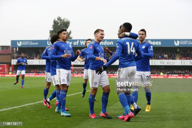 Kelechi Iheanacho of Leicester City celebrates with his team mates after scoring to make it 0-1 during the FA Cup Fourth Round match between...