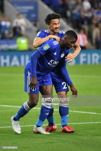 Kelechi Iheanacho of Leicester City celebrates with team mate Shinji Okazaki after scoring his team's third goal during the Carabao Cup Second Round...