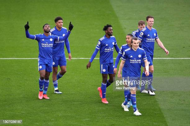 Kelechi Iheanacho of Leicester City celebrates with team mates after scoring their side's third goal during the Premier League match between...