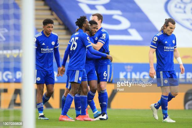 Kelechi Iheanacho of Leicester City celebrates with Wilfred Ndidi and Jonny Evans after scoring their side's third goal during the Premier League...