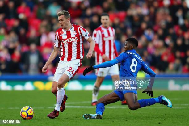 Kelechi Iheanacho of Leicester City challenges Darren Fletcher of Stoke City during the Premier League match between Stoke City and Leicester City at...