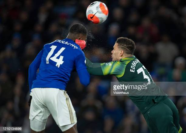 Kelechi Iheanacho of Leicester City collides with Manchester City goalkeeper Ederson in action during the Premier League match between Leicester City...