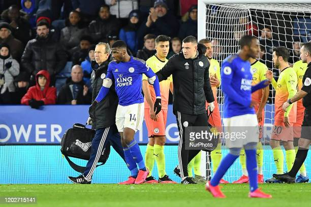 Kelechi Iheanacho of Leicester City gets medical attention after being fouled by Ederson of Manchester City during the Premier League match between...
