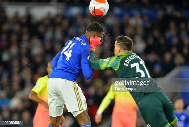 Kelechi Iheanacho of Leicester City heads towards goal and clashes with Ederson of Manchester City during the Premier League match between Leicester...