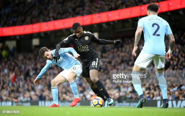 Kelechi Iheanacho of Leicester City in action with Bernado Silva of Manchester City during the Premier League match between Manchester City and...