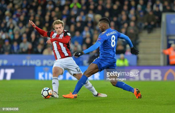 Kelechi Iheanacho of Leicester City in action with James Wilson of Sheffield United during the FA Cup fifth round match between Leicester City and...