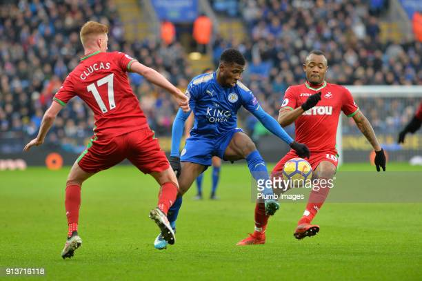 Kelechi Iheanacho of Leicester City in action with Jordan Ayew and Sam Clucas of Swansea City during the Premier League match between Leicester City...