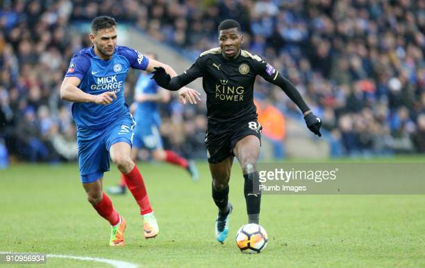 Kelechi Iheanacho of Leicester City in action with Ryan Tafazolli of Peterborough United during The Emirates FA Cup Fourth Round tie between...