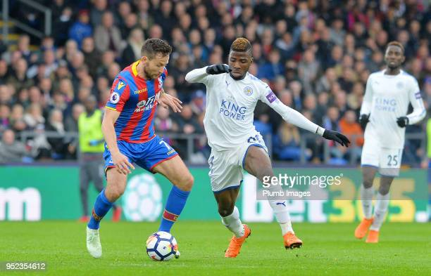 Kelechi Iheanacho of Leicester City in action with Yohan Cabaye of Crystal Palace during the Premier League match between Crystal Palace and...