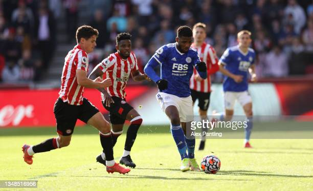 Kelechi Iheanacho of Leicester City is challenged by Christian Norgaard of Brentford during the Premier League match between Brentford and Leicester...