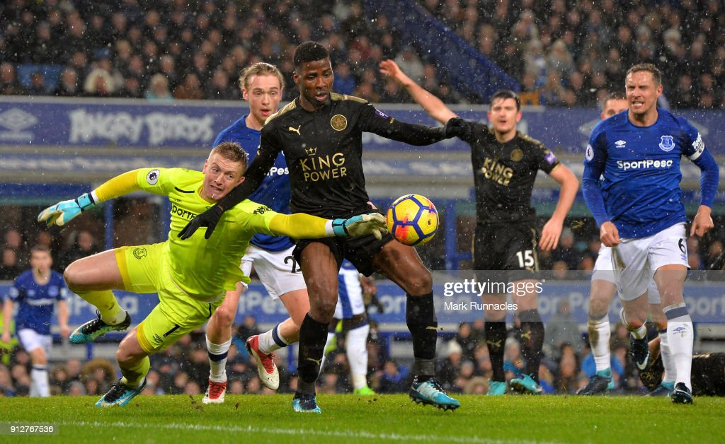 Kelechi Iheanacho of Leicester City is challenged by Jordan Pickford of Everton during the Premier League match between Everton and Leicester City at Goodison Park on January 31, 2018 in Liverpool, England.
