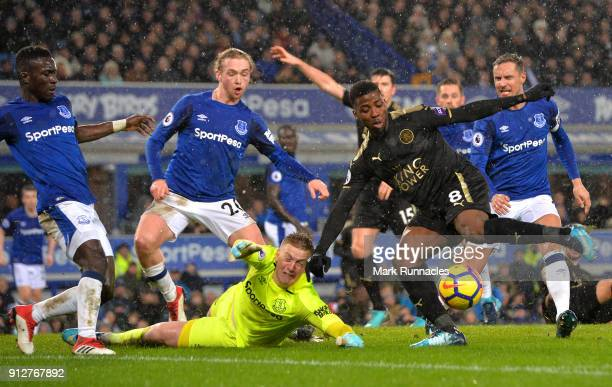 Kelechi Iheanacho of Leicester City is challenged by Jordan Pickford of Everton during the Premier League match between Everton and Leicester City at...