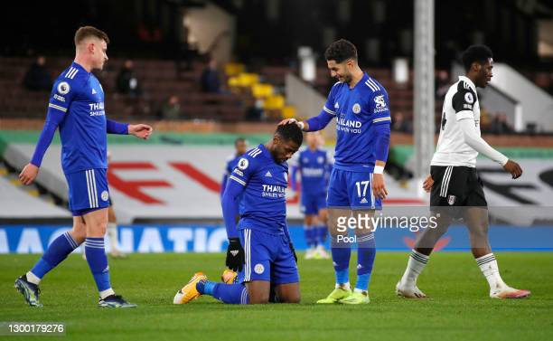 Kelechi Iheanacho of Leicester City is congratulated by team mates Harvey Barnes and Ayoze Perez after scoring their side's first goal as Ola Aina of...