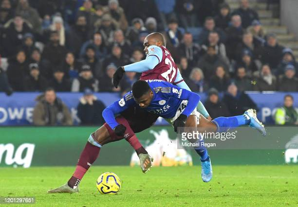 Kelechi Iheanacho of Leicester City is fouled by Angelo Ogbonna of West Ham United leading to a penalty later scored by Ayoze Perez during the...