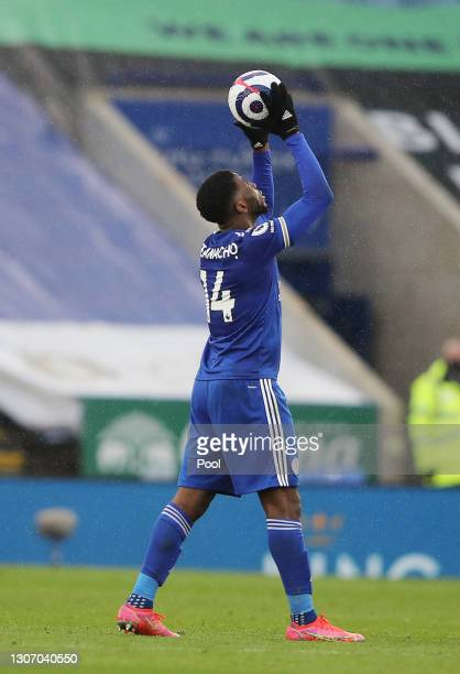 Kelechi Iheanacho of Leicester City leaves the pitch with the match ball after scoring a hat trick during the Premier League match between Leicester...