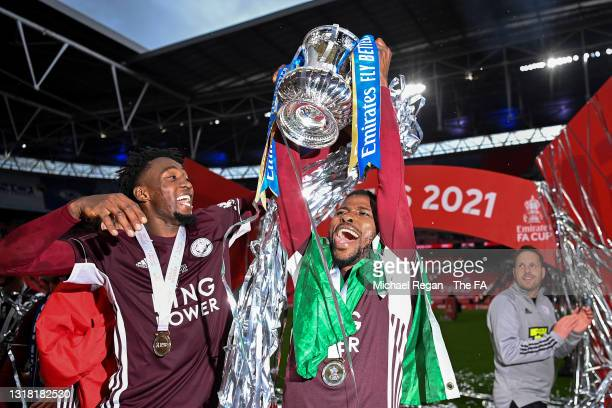 Kelechi Iheanacho of Leicester City lifts the Emirates FA Cup trophy with team mate Wilfred Ndidi following The Emirates FA Cup Final match between...