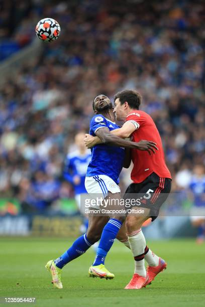 Kelechi Iheanacho of Leicester City runs into Harry Maguire of Manchester United during the Premier League match between Leicester City and...
