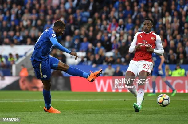 Kelechi Iheanacho of Leicester City scores his sides first goal as Danny Welbeck of Arsenal looks on during the Premier League match between...