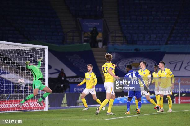 Kelechi Iheanacho of Leicester City scores his team's first goal past Christian Walton of Brighton & Hove Albion during The Emirates FA Cup Fifth...