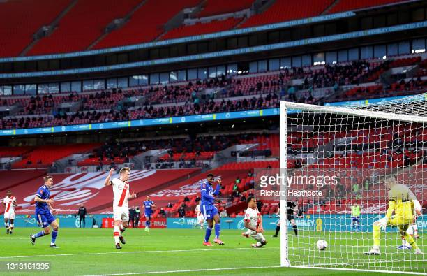 Kelechi Iheanacho of Leicester City scores his team's first goal past Fraser Forster of Southampton during the Semi Final of the Emirates FA Cup...